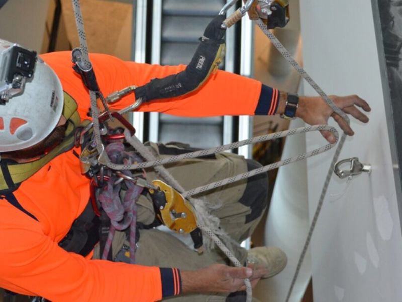 experienced worker using a safety harness