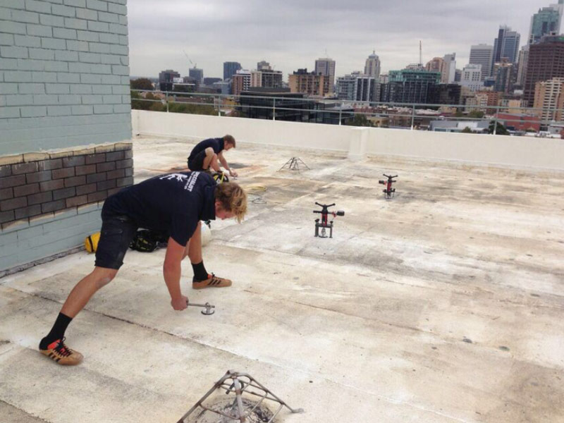 2 SHA skilled workers carrying out inspection testing on a rooftop
