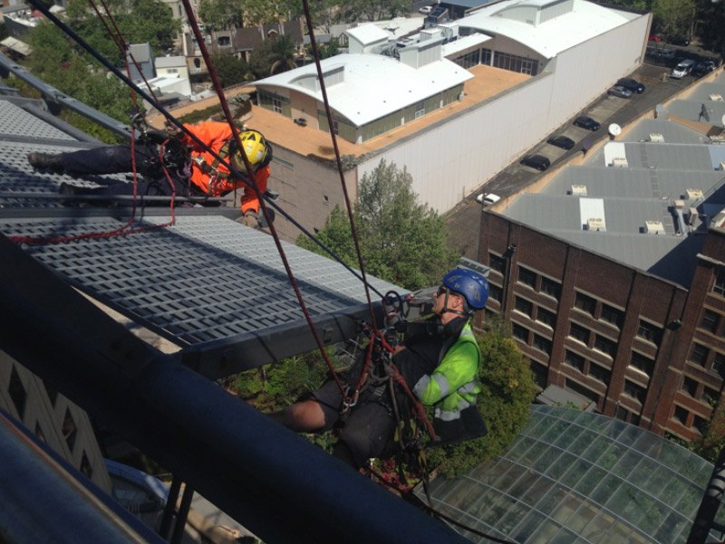 Repairing a building facade at heights