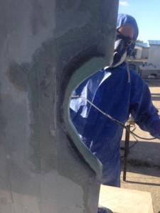 SHA worker repairing a wind turbine